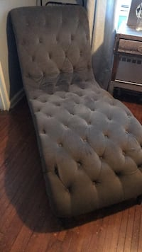 Charcoal grey tufted chaise lounge with wooden legs in great condition.