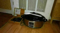 silver and black electric cooker and hot stone mas