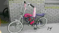 Pink purple Schwinn low rider, gas motorized Garland