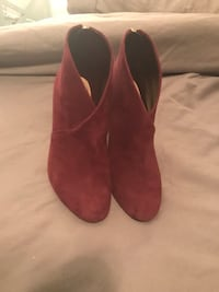 Pair of plum purple suede boots