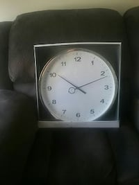 gray analog clock