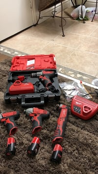 Milwaukee set 3 drills and a multi tool plus Four battery's also two charges very good deal