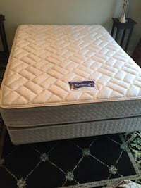 quilted white and gray mattress