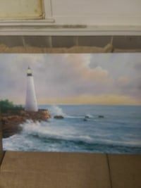 brown wooden framed painting of lighthouse