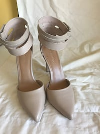pair of white leather peep-toe ankle strap heels Toronto, M1H 1A9