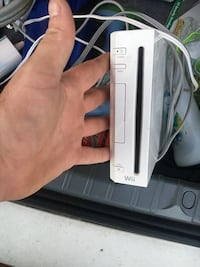White nintendo wii game console come with all hook ups. Sensor bar and couple games Pace, 32571