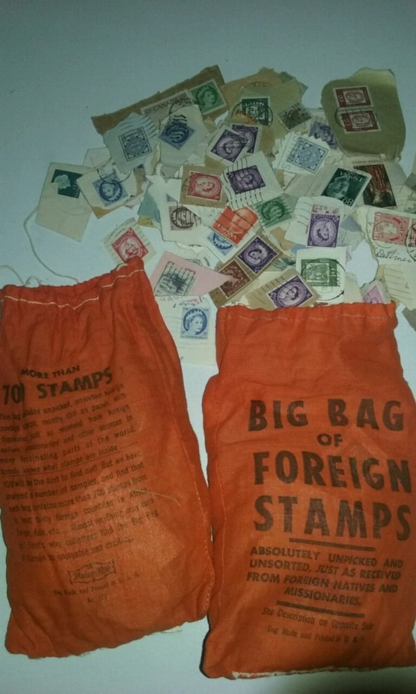Two bags full of foreign stamps a1fddc0a-5c3e-43f3-9105-31a6c5b824b0