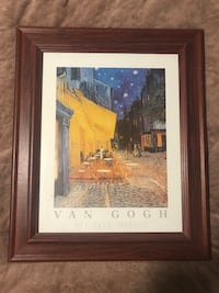 brown wooden framed painting of The Cafe Terrace by Van Gogh