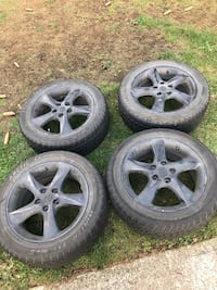 Four black 5-spoke car wheels with tires 17 inch Abbotsford, V2T 2V1