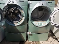two white washer and dryer set