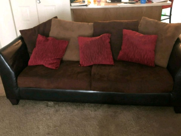 brown and black suede sofa