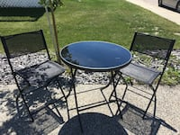 round black metal patio table with four chairs Edmonton, T6V 0A7