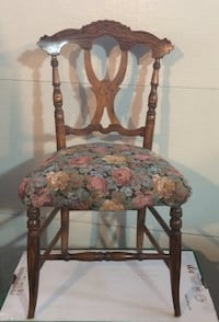 Brown wooden framed pink, brown and red floral print pad chair. Vaughan, L6A 1E8
