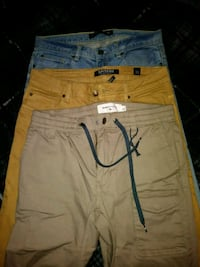 two blue and brown denim shorts