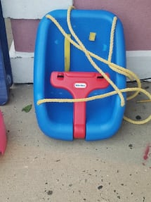 blue and red Little Tikes swing chair