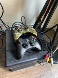 black Xbox 360 with two controllers 2330 mi
