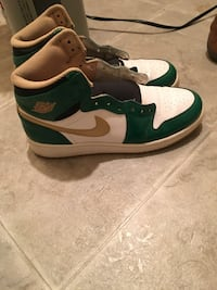 pair of white-and-green Nike basketball shoes