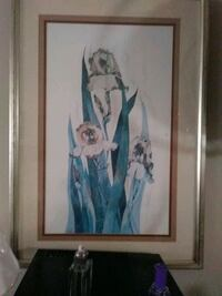 woman in blue dress painting with brown wooden frame Edmonton, T5P 2N8
