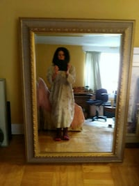 Large gold design mirror. Measurements are 31 1 Toronto, M9A