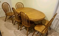 Like new oak dining table w/ leaf & 6 chairs Manassas, 20110