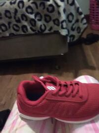 unpaired red Nike running shoe Clinton, 73601