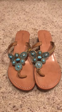 pair of brown leather thong sandals 897 mi