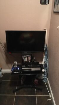 flat screen television with TV console