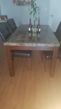 Marble top dining table. 6 seater/only 4 chairs North Bay Village, 33141