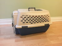 Beige  and blue pet carrier