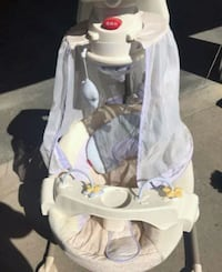 Like new baby swing/battery&electric operated