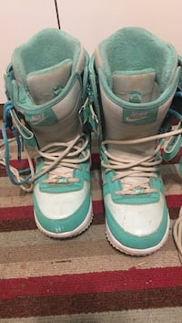 teal-and-white Nike boots