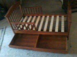 brown wooden crib with changing table
