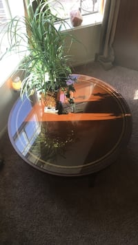 round brown wooden framed glass top coffee table Deltona, 32738