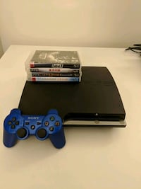 black Sony PS3 Slim with two controllers Tysons, 22102