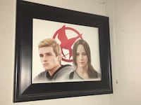 Mocking jay character painting with black framed