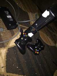 black and gray Sony PS4 with controller 919 mi