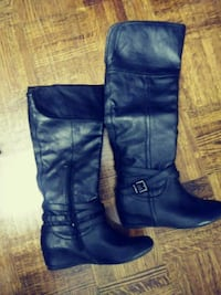 pair of black leather knee-high boots Toronto, M3C 1B5