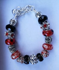 Red and black charm bracelet 2 for $25 Baltimore, 21224