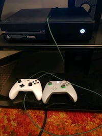 Xbox One console with two controllers 922 mi