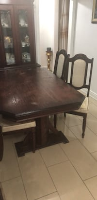 Black wooden table with chairs Mississauga, L4T 2A3