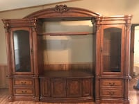 brown wooden TV hutch with flat screen television OPELOUSAS