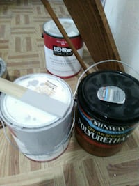 three assorted paint pail with lid