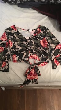 black, red, and white floral long sleeve shirt
