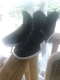pair of black leather lace-up boots 758 mi