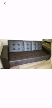 tufted dark brown sofa with storage on the sides Irvine