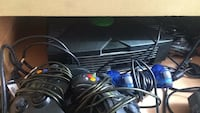 black Xbox One console with controller and game cases San Francisco, 94110