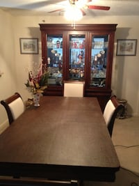 Formal dining set mahogany table pad, 4 chairs, 2 arm chairs, lighted china cabinet Alexandria, 22303