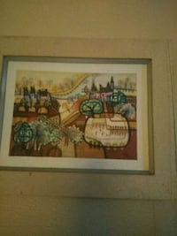brown wooden framed painting of people 1300 mi