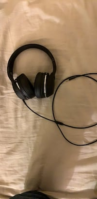 black and gray corded headphones