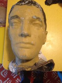 Human face sculpture mounded head odd item a must have?